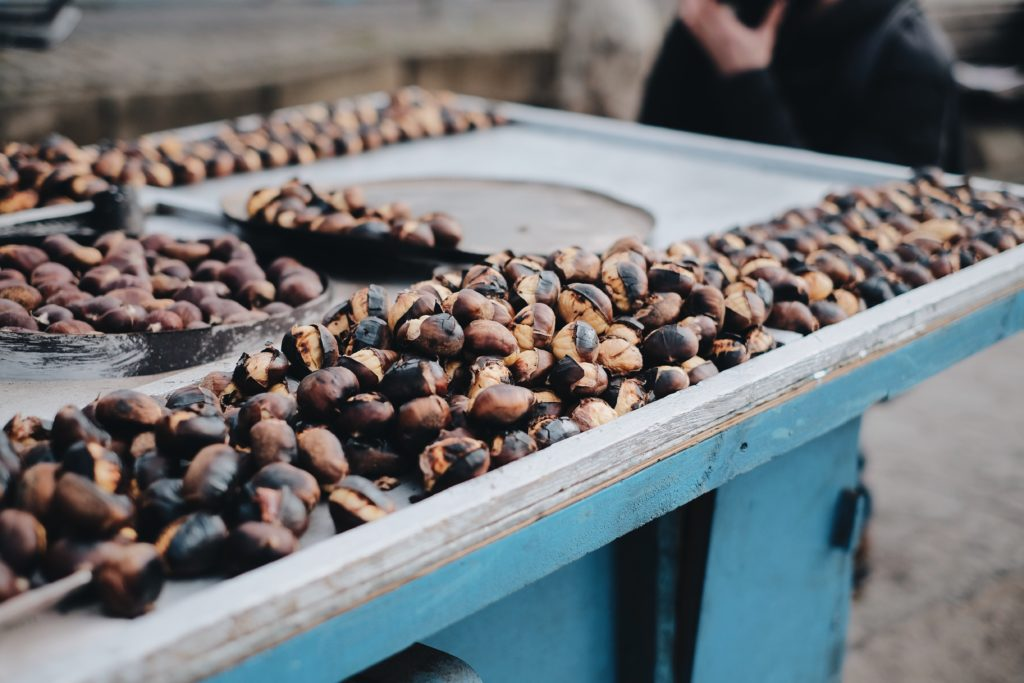Roasted chestnuts - a favorite fall delicacy among locals. Photo by Emre on Unsplash